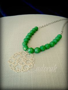 Green Czech Glass Faceted Beads with a Silver-plated Bubble Medallion