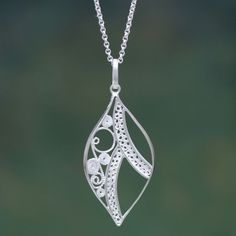 NOVICA Leaf Shape Sterling Silver Filigree Pendant Necklace ($65) ❤ liked on Polyvore featuring jewelry, necklaces, pendant, sterling silver, sterling silver pendant necklace, handcrafted jewelry, leaf jewelry, filigree jewelry and filigree pendant