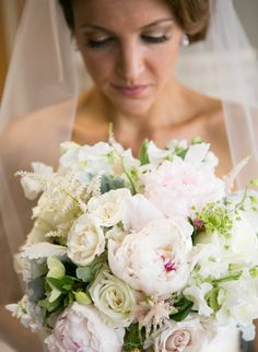 A soft garden bouquet filled with blooms of Peonies, Astilbe, Hellebores, Hydrangea and Sweet Pea.  See more here: http://www.viburnumdesigns.com