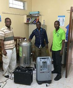 Maternal Childhealth Advocacy International | LIBERIA - New oxygen generator at Phebe Operating Room.  Pictured left to right: Aaron Sonah – Nurse Anaesthetist, Head of Critical Care.  Jeremiah Akoi – MCAI Logistician.  Akoi Miller – Nurse Anaesthetist, who worked throughout the Ebola outbreak.