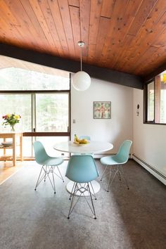 Blue Eames Side Chairs might be my favorite. Love this simple, mid-century dining room.   Find these styles and more at www.smartfurniture.com