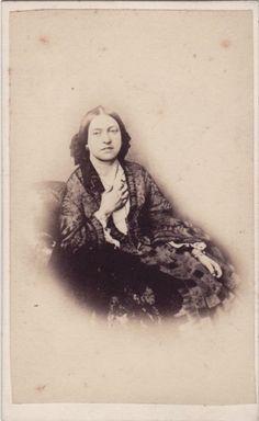 A smiling Queen Victoria.