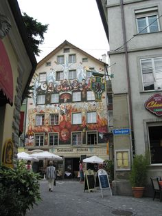 Lucerne, Switzerland - William Tell country.  Not far from Zurich and Bern.  Narrow cobblestone streets, spires and turrets, covered bridges, frescoed houses and fountains.