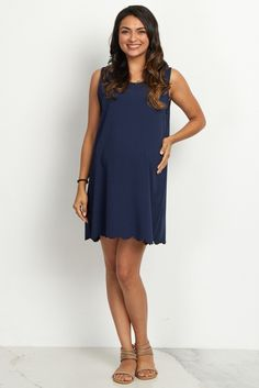 This gorgeously feminine maternity dress is going to be your new favorite piece in your closet. A pretty scalloped hem gives you a girly flare while a sleeveless cut will keep you cool all day and night. Dress this piece up with a statement necklace and heels for a chic ensemble that will have heads turning.