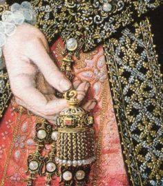 Tudor Fashion: Aside from the pearls on the intricately wrought gold girdle, this gown is very costly, and shows the wearer's status. A true black was incredibly difficult to achieve, and required multiple sessions in the dye vats. And so black fabric - especially the black velvet she wears - was extremely expensive. It is decorated with bands of cloth-of-gold and cloth-of-silver embroidery. The underskirt is scarlet satin brocade (scarlet was forbidden to the lower classes by sumptuary…