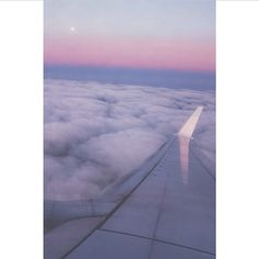 airplane clouds travel sky