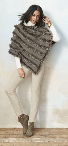 Make this faux-fur poncho your ultimate fall indulgence. Angled faux-fur stripes add soft, touchable texture.