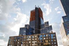 """The """"Poor Door"""" and the Glossy Reconfiguration of City Life: One Riverside Park, the luxury-condominium complex on Riverside Boulevard, at Sixty-second Street, has a separate entrance for its fifty-five affordable units."""