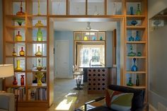 Built-in cabinets are a classic separation between the living and dining rooms in Arts and Crafts homes. Try updating this classic look for your home with open, geometrical cubbies