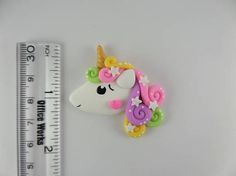 Unicornio de pelo rizado. Scapbooking encanto Handmade Clay