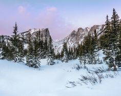 After snowshoeing in the dark to arrive at Dream Lake I was rewarded with a beautiful sunrise. Wildlife Nature, Beautiful Sunrise, Rocky Mountain National Park, Rocky Mountains, Winter Wonderland, Nature Photography, Colorado, National Parks, Sky