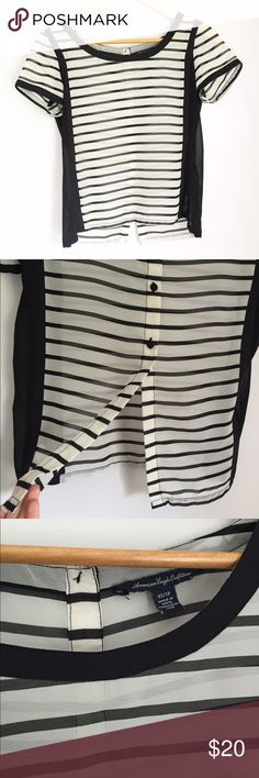 AEO Black & White Striped Sheer Blouse American Eagle Outfitters XS black and white striped short sleeve blouse top. Black side panels. Cute buttons / split back detail. Mostly sheer. In great condition, only worn a handful of times. One tiny spot on front (pictured). I'm happy to answer any questions you may have! American Eagle Outfitters Tops