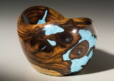 Larry Favorite | Sculpted desert ironwood, inlaid with turquoise.