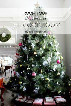 Christmas Room Tour - Christmas tree, fireplace mantle with stockings and wreath hanging on mirror.
