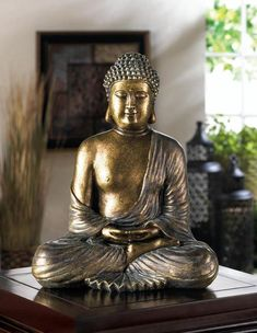 This beautiful Buddha statue will bring a calming influence into your living space with fantastic style. Deep in meditation, Buddha is seated in the lotus position with eyes closed, and his bronze, metallic-like finish will add depth and a. Lotus Buddha, Art Buddha, Buddha Decor, Buddha Zen, Black Buddha, Buddha Statue Home, Small Buddha Statue, Buddha Statues, Golden Buddha Statue
