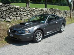 2003 Ford Mustang:  My Single girl Dream car but wish it was a GT!  I miss her.  I will own another one day