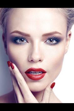 Chaleen....ex coworker of Jesse. Also past girlfriend. Blonde chignon hairdo. Hazel eyes. Wears red lipstick and fingernail polish