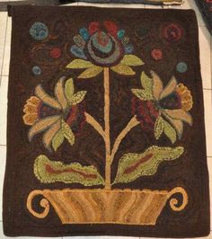 Flowers in a pot hooked rug