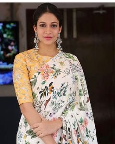 White floral saree paired with yellow floral blouse for festivals Saree Blouse Designs, Blouse Patterns, Sari Blouse, Blouse Neck, Saree Dress, Indian Dresses, Indian Outfits, Floral Print Sarees, Printed Sarees