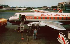 Chicago Midway Airport - Capital Airlines - Vickers Viscount 745D Chicago Midway Airport -  (1959) (N7411) Checking the Rolls-Royce Dart 510 engines to make sure all 1,576hp are there. Photo by Mel Lawrence.