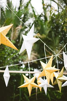 Hanging yellow and white star decor for Mexico destination wedding - Photo by Jillian Mitchell
