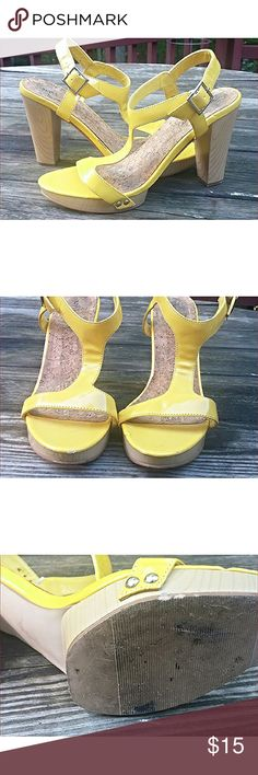 Yellow Wooden Heels These lovely wooden heels are well loved with slight scuffing. I'm selling these because I rarely wear open toed heels anymore because I work as a manager at a restaurant! New York & Company Shoes Platforms