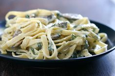 Lower Fat Fettuccine Alfredo with Spinach and Mushrooms from @Angie McGowan (Eclectic Recipes)