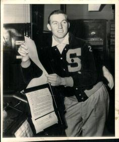Al Kaline in his high school letter jacket holding his first contract with the Detroit Tigers, in 1953.