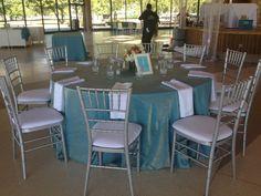 Turquoise Crush with White satin napkins. Silver Chiavari chairs.