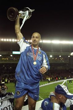 13 May 1998: Chelsea Player/Manager GIANLUCA VIALLI holds the trophy aloft after the European Cup Winners Cup final against VfB Stuttgart at the Rasunda Stadium in Stockholm, Sweden. CHELSEA won the match 1-0...