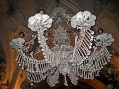 Sedlec Ossuary - A Roman Catholic chapel with 40,000 - 70,000 peoples bones arranged in an artistic fashion.