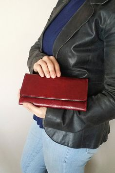 Check out this item in my Etsy shop https://www.etsy.com/nl/listing/287870723/dark-red-leather-wallet-purse-clutch