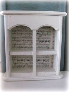 Painted curio cabinet with sheet music decoupaged inside for accent.