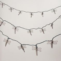 Copper Dragonfly 10 Bulb String Lights - World Market from Cost Plus World Market. Saved to Room Decor. Outdoor Fairy Lights, String Lights Outdoor, Outdoor Lighting, Laser Christmas Lights, Dragonfly Decor, Starry String Lights, Paper Lantern Lights, Outdoor Pouf, Best Commercials