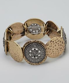 When it comes to timeless treasures, nothing tops a simple stretch bracelet. This piece sparkles with hammered and embellished discs that overlap for a sophisticated silhouette.