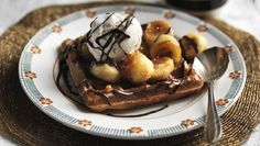 Waffles with hot chocolate sauce, fried bananas and ice cream |      Someone very special deserves these waffles, loaded with fried bananas, chocolate sauce and ice cream. It's probably you.Equipment: You will need a waffle maker.