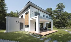 A two-storey kit house developed by Weberhaus.  #trees #sky #germanhouse