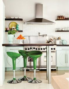 I have always liked these stools. Also really like the dark shelves on the light walls