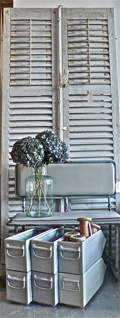 French shutters & folding bench & industrial crates & milk jar & flowers (not industrial).