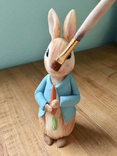 Learn how to create a Peter Rabbit figurine out of modeling chocolate with this tutorial; perfect for a Peter Rabbit themed cake. Peter Rabbit Figurines, Peter Rabbit Cake, Peter Rabbit Birthday, Peter Rabbit Party, Fondant Rabbit, Baby Boy Birthday Cake, 2nd Birthday, Camo Wedding Cakes, Rabbits