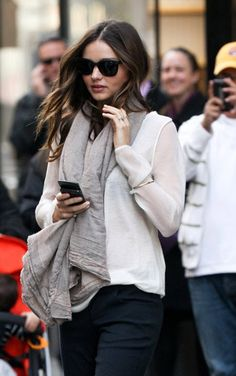 Miranda Kerr casual simple street style. Attention to accessories: sunglasses and cosy grey scarf