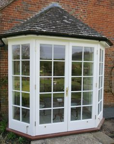 Hardwood french doors with sidelights forming a bay Bay Window Exterior, Garage Exterior, Craftsman Exterior, French Doors With Sidelights, Windows And Doors, Bay Windows, French Doors Patio, Patio Doors, Small Enclosed Porch
