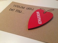 This card is the perfect way to ask the girls the big question. Ask in style with these unique, carefully designed cards. The wooden hearts are hand-painted an