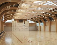 Completed in 2011 in Drancy, France. Images by Clément Guillaume. The gymnasium Regis Racine is situated in Drancy north east Paris. the program of this building includes: an indoor sports hall 22 meters long and Gymnasium Architecture, Timber Architecture, Architecture Details, Villa Del Carbon, Paris Atelier, Timber Structure, Roof Design, House Roof, Atrium