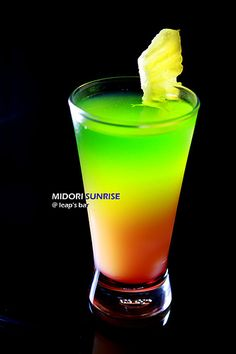 Midori Sunset -- 1oz Midori 1oz Vodka shake with ice   1/2 Grenadine 4oz of Orange Juice Midori Mix layer in a glass