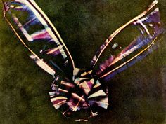 """The first colour photograph, taken in 1861, was of a Snitch! -- Not really… Scottish physicist James Clerk Maxwell is responsible for creating this intriguing image of tartan ribbon in 1861. By photographing the ribbon three times through red, blue and yellow filters, Maxwell could combine the images into one full-colour composite. A milestone moment for the art and technological evolution of photography. Oh and a pretty striking image in its own right!"""