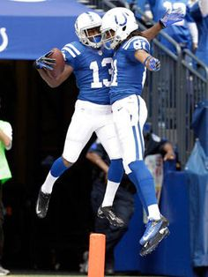 Indianapolis Colts wide receiver T.Y. Hilton, let, celebrates with wide receiver Kris Adams after scoring a touchdown against the Jacksonville Jaguars