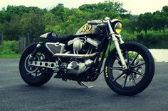This bike started off as a '95 Harley Davidson Sportster 883. It's this now! Looks good.