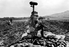 Larry Towell - NICARAGUA. Nueva Segovia. Santa Cruz Potato Cooperative. 1984. A member of the local civil defense militia guards against the invading U.S.-backed counterrevolutionary Contras.