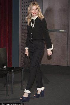 Well suited:For the star-studded screening, the star wore black straight leg trousers wit...